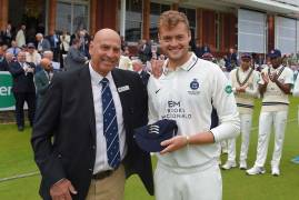 TOM HELM AWARDED COUNTY CAP